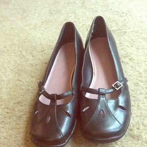 Black, flat Mary Jane style shoes